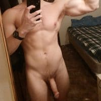 flexing-boy-cut-dick